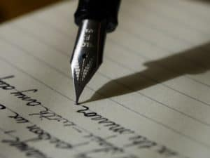 0008 Writing in a Journal - Unsplashed